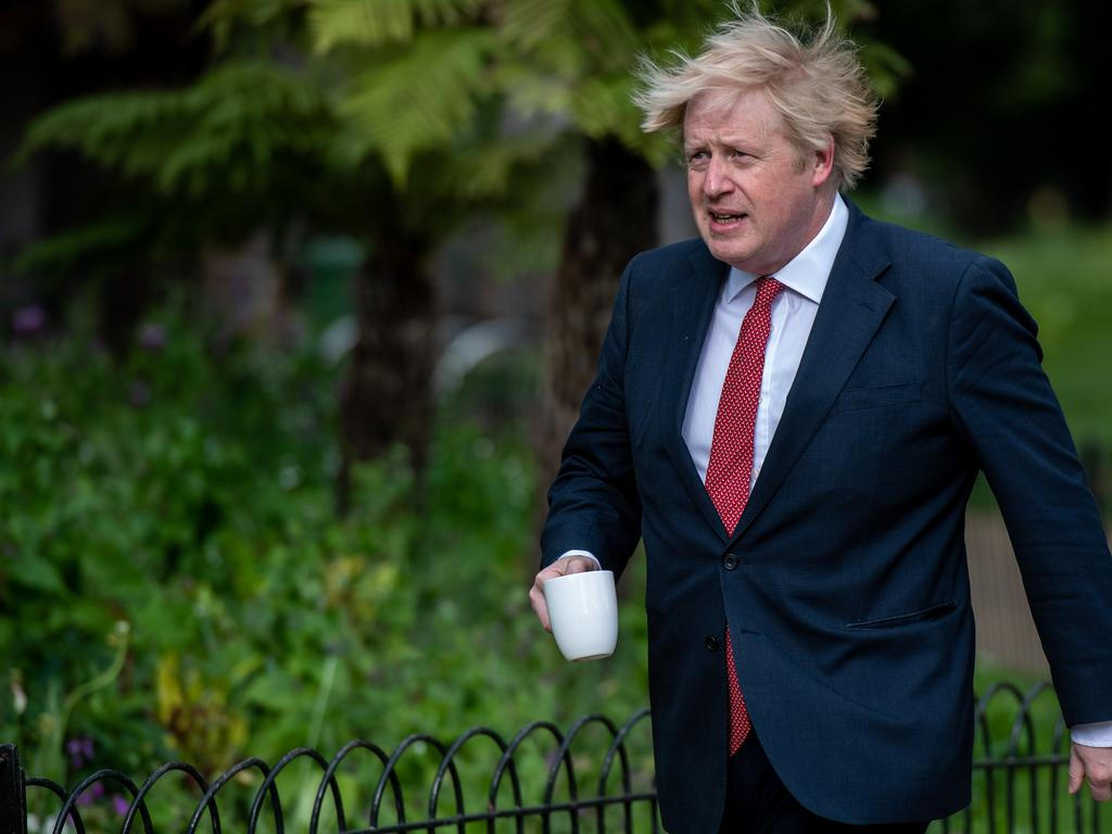 Boris Johnson taking a walk on his way to work. Picture: Chris J Ratcliffe/Getty Images.