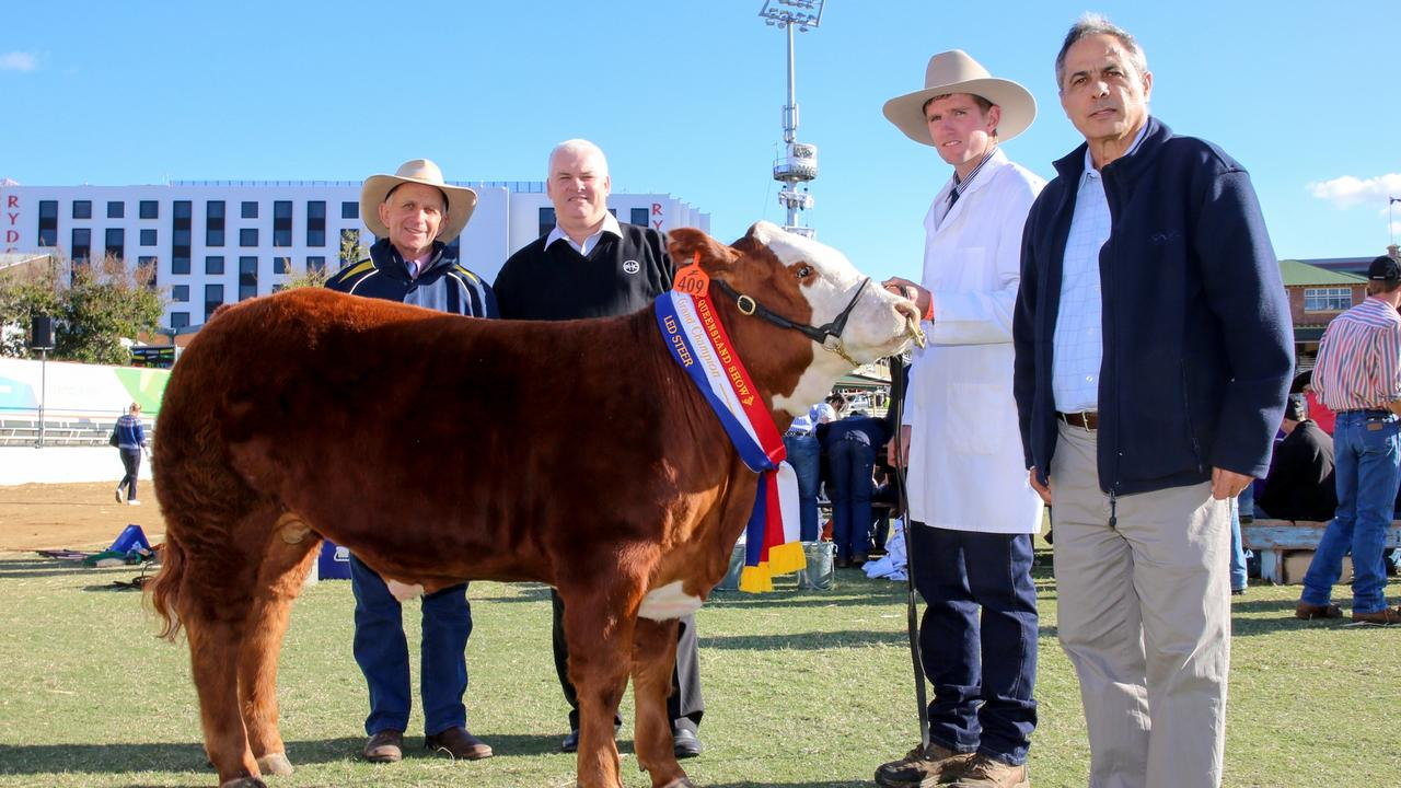 Breakfast Creek Hotel General Manager Sam Gullo (right) purchased the Ekka Grand Champion Led Steer for $22/kg. Mr Gullo is pictured with steer owner Chris Law, Hunda Hereford, Quirindi, NSW, Tony Wood, Qld Food Operations Manager, ALH, and handler Jamie Grosser. PICTURE: ANDREA CROTHERS.