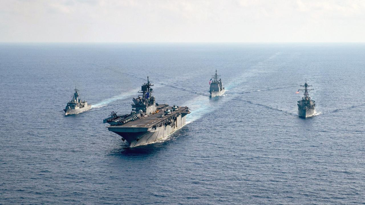 "The Royal Australian Navy guided-missile frigate HMAS Parramatta (FFH 154), left, in late April 2020 with the U.S. Navy amphibious assault ship USS America, guided-missile cruiser USS Bunker Hill and guided-missile destroyer USS Barry ""in support of security and stability in the Indo-Pacific region"". Picture: US Navy"