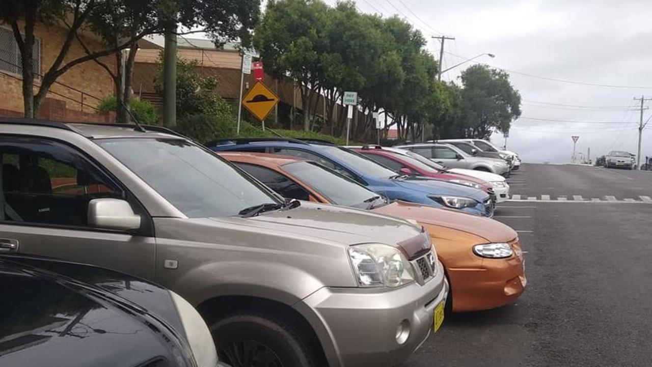 Cars parked outside Lismore Base Hospital have all been issued parking fines after some confusion over where free parking is available.