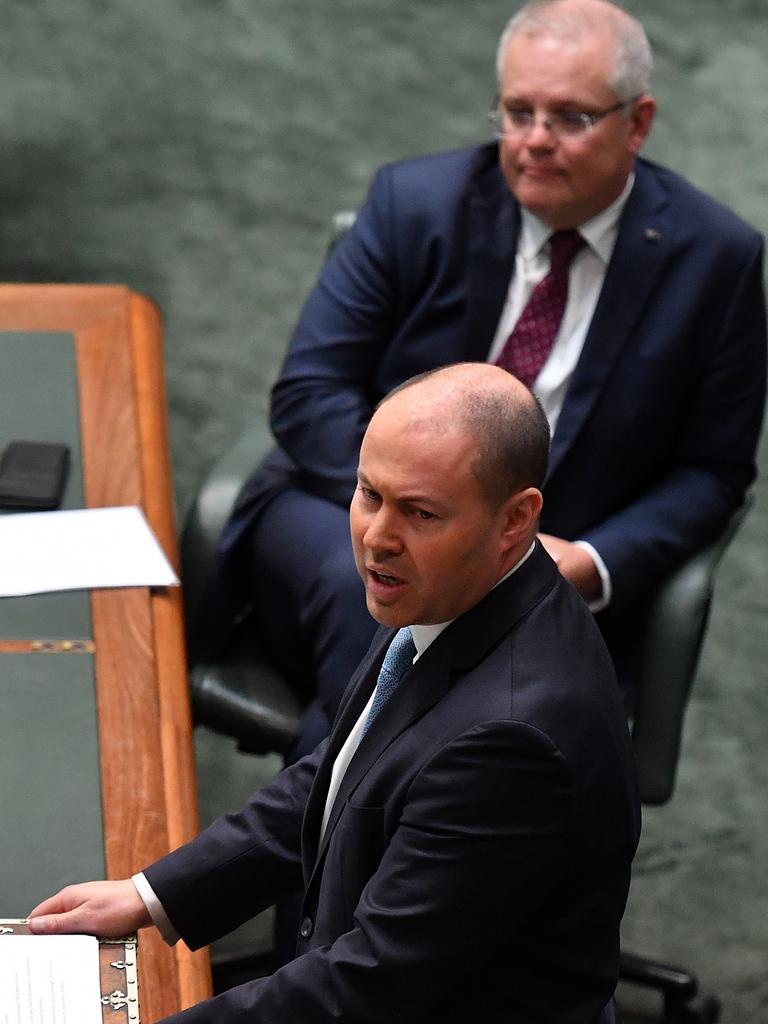 Prime Minister Scott Morrison listens as Treasurer Josh Frydenberg delivers the statement. Picture: AAP