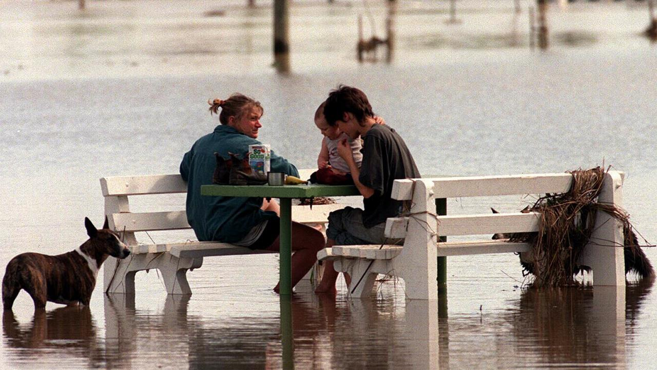 Picnic table surrounded by water in flooded Grafton park, flood caused by heavy rain. New South Wales (NSW) / Weather / Floods