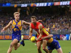 Clubs, league stunned: AFL restart plans thrown into chaos