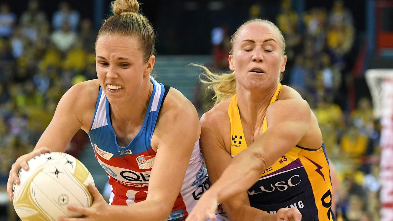 Paige Hadley of the Swifts (left) wins the ball over Laura Langman of the Lightning during the Super Netball Grand Final between the Sunshine Coast Lightning and the New South Wales Swifts at the Brisbane Entertainment Centre in Brisbane, Sunday, September 15, 2019. (AAP Image/Dave Hunt) NO ARCHIVING, EDITORIAL USE ONLY
