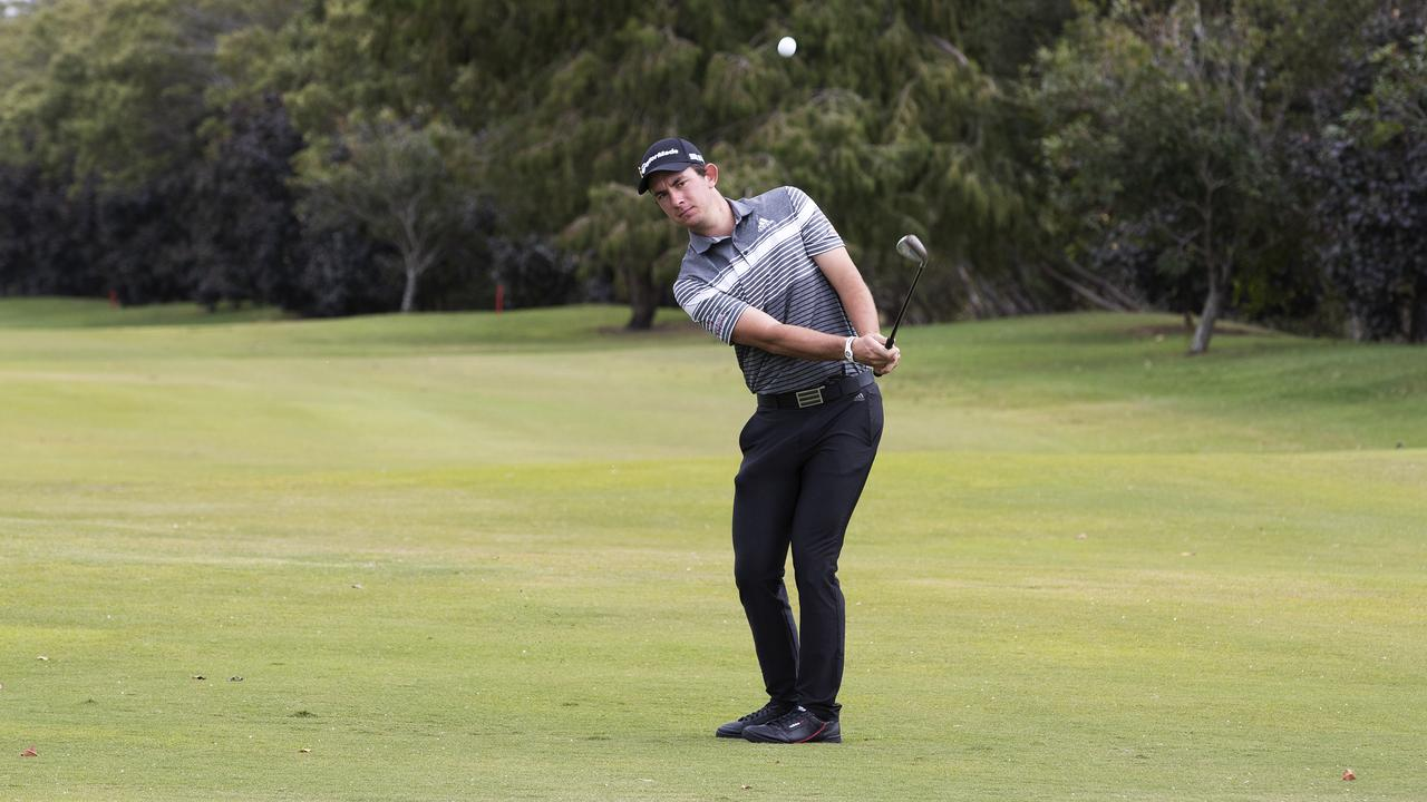 CHIPPING: Lucas Herbert at Royal Queensland Golf Club in Brisbane last week. Picture: News Corp/Attila Csaszar.