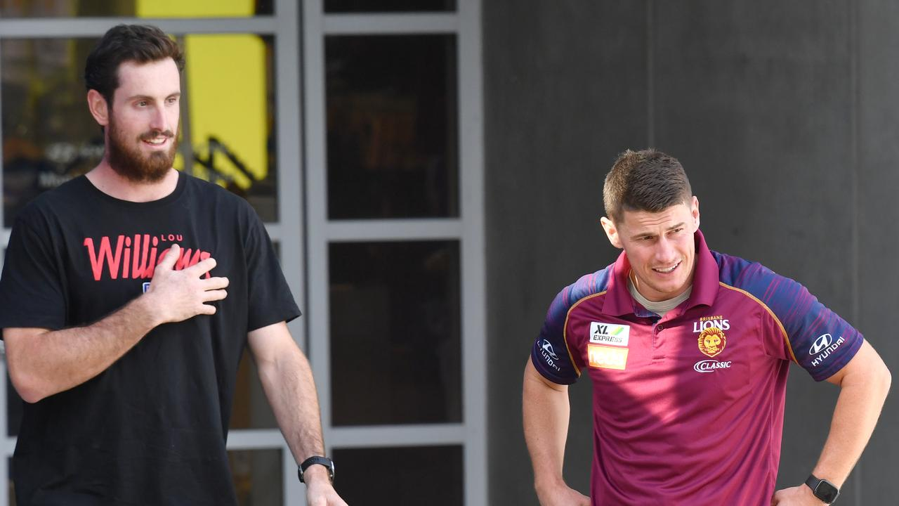 Brisbane players Darcy Gardiner (left) and Dayne Zorko leave the Gabba after they were tested for coronavirus. Picture: AAP