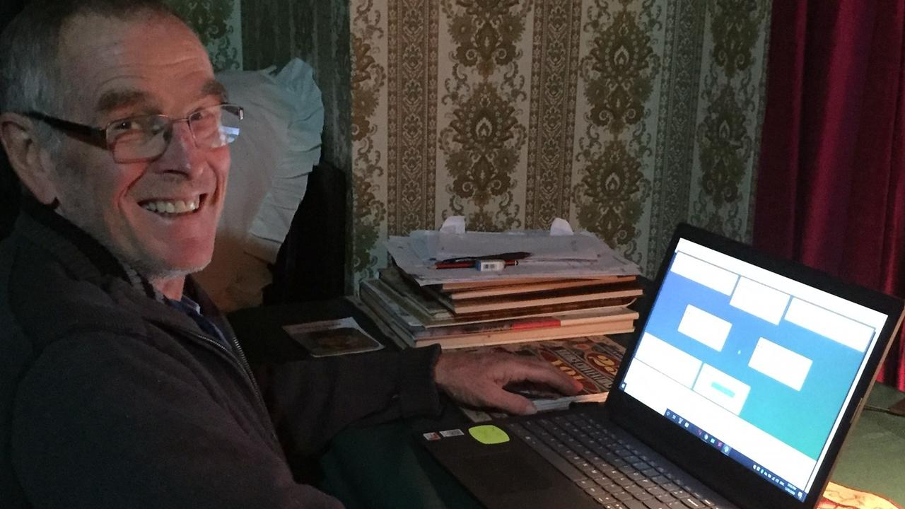 Bob Northam at his computer for a game of online bridge.