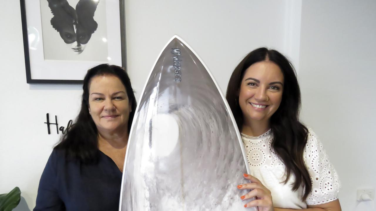 Judy Littler (left) won a custom made Mt Woodgee surf board, among other prizes, after buying tickets for a fundraiser to support wildlife organisations supporting bushfire affected animals. Rachel Hannah (right) was just one of 12 salons across the Tweed and Gold Coast who organised the event.