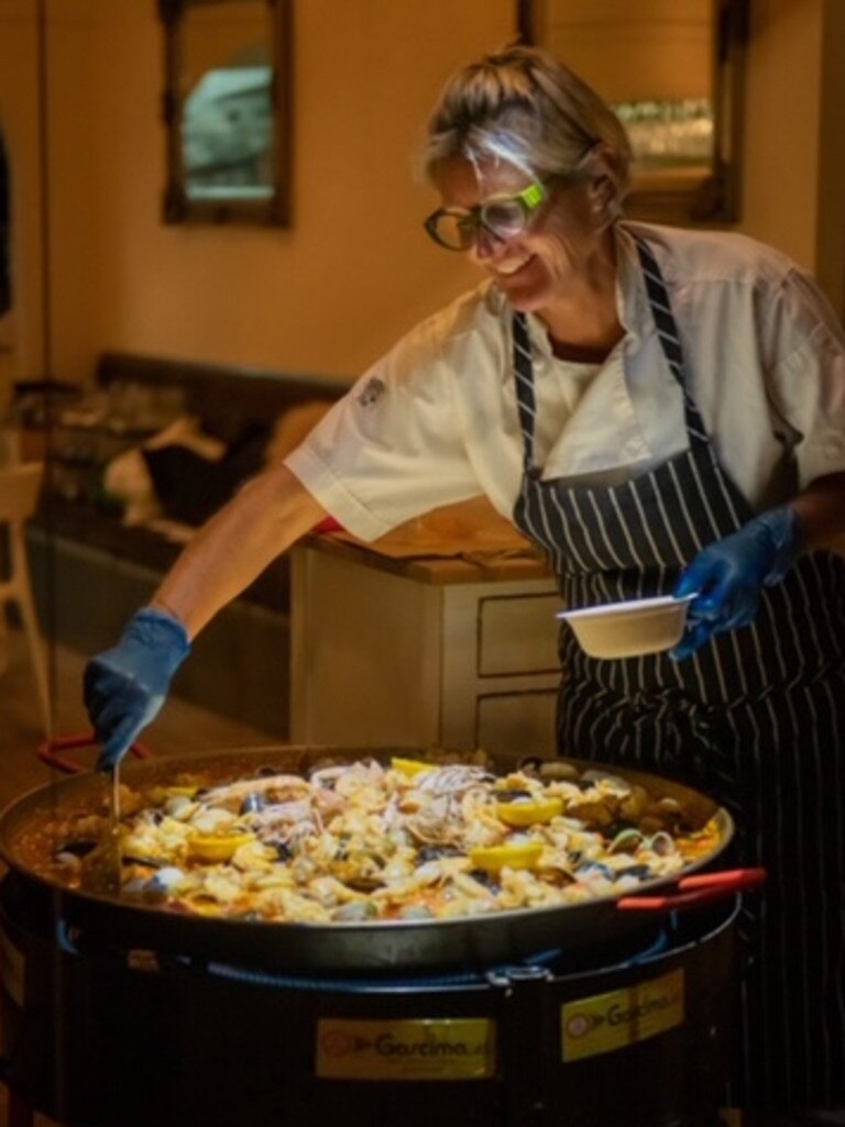 Sunday paella lunches will continue to be served when La Vida fine dining seafood restaurant in Hastings St, Noosa reopens this weekend. Pictured is restaurant owner Sarah Hooper stirring the paella.