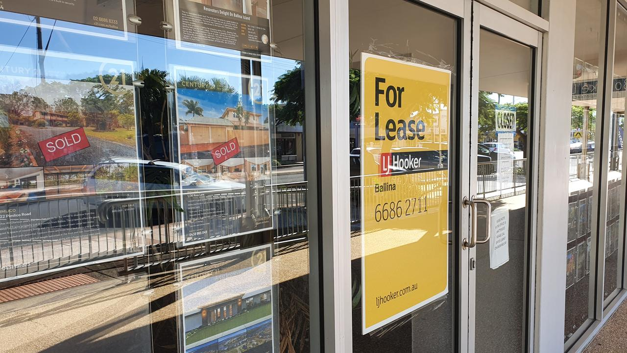 Signs at the closed Century 21 office in Ballina.