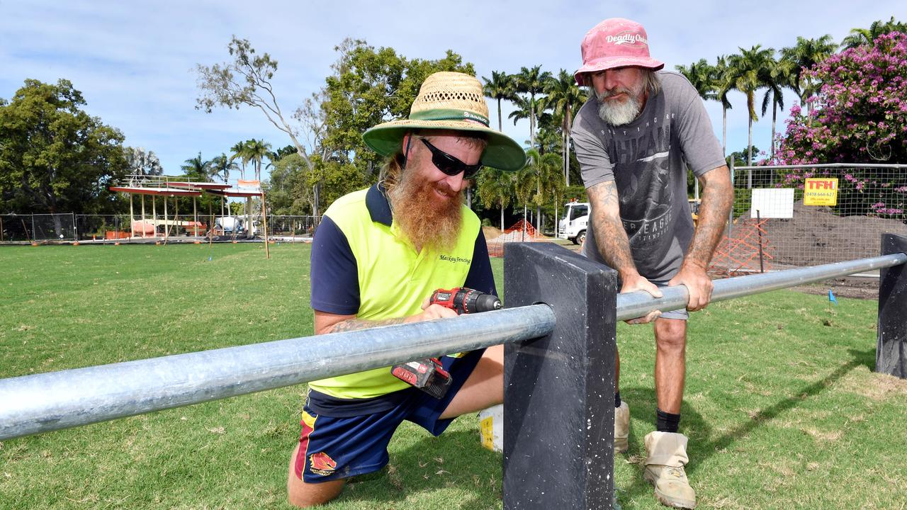 Daniel Perry and Michael Bradford from Mackay Fencing work on a ballast that surrounds Queens Park. Picture: Tony Martin
