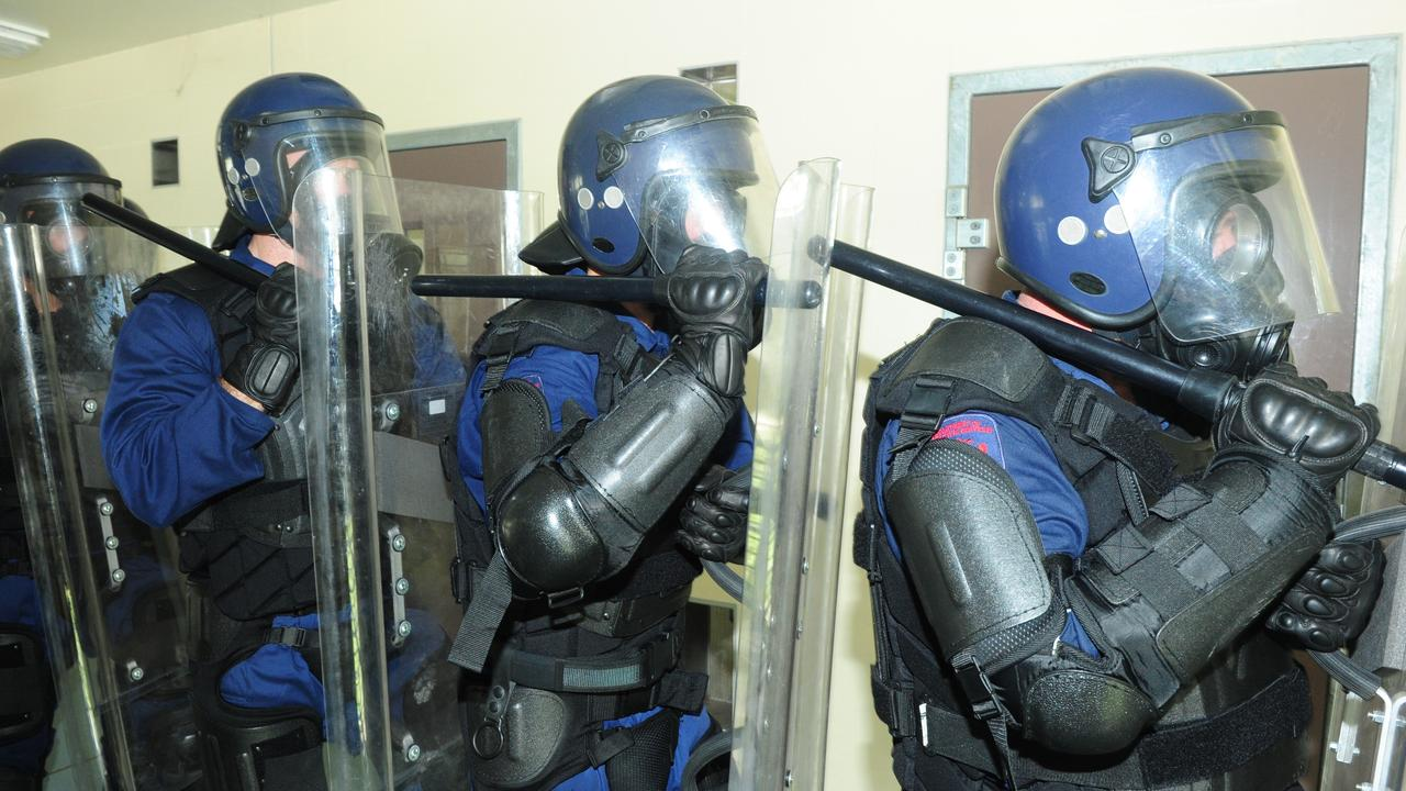 The Critical Emergency Response Team carries out a prison riot scenario at the women's area of Stuart Prison.The  Townsville correctional facility guards were  taking part in their monthly training session.