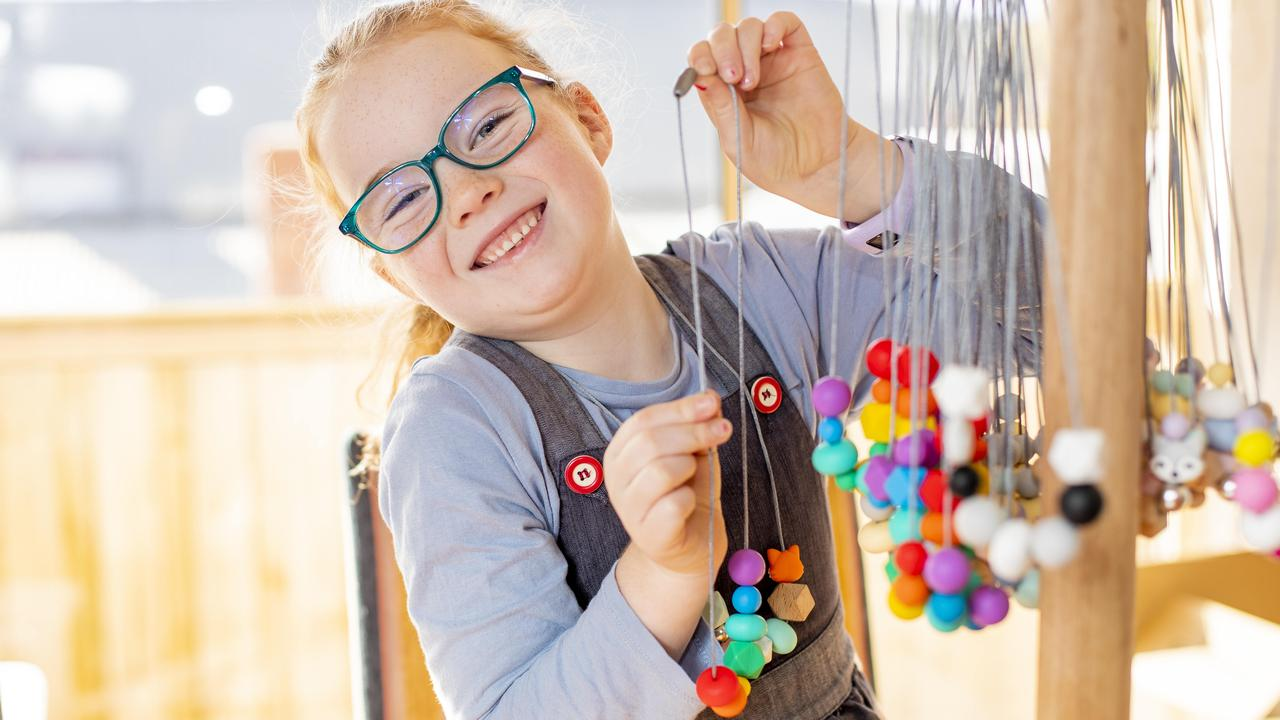Scarlett Fox, 6, has been making bead necklaces to raise funds for Cystic Fibrosis Tasmania. Picture: RICHARD JUPE