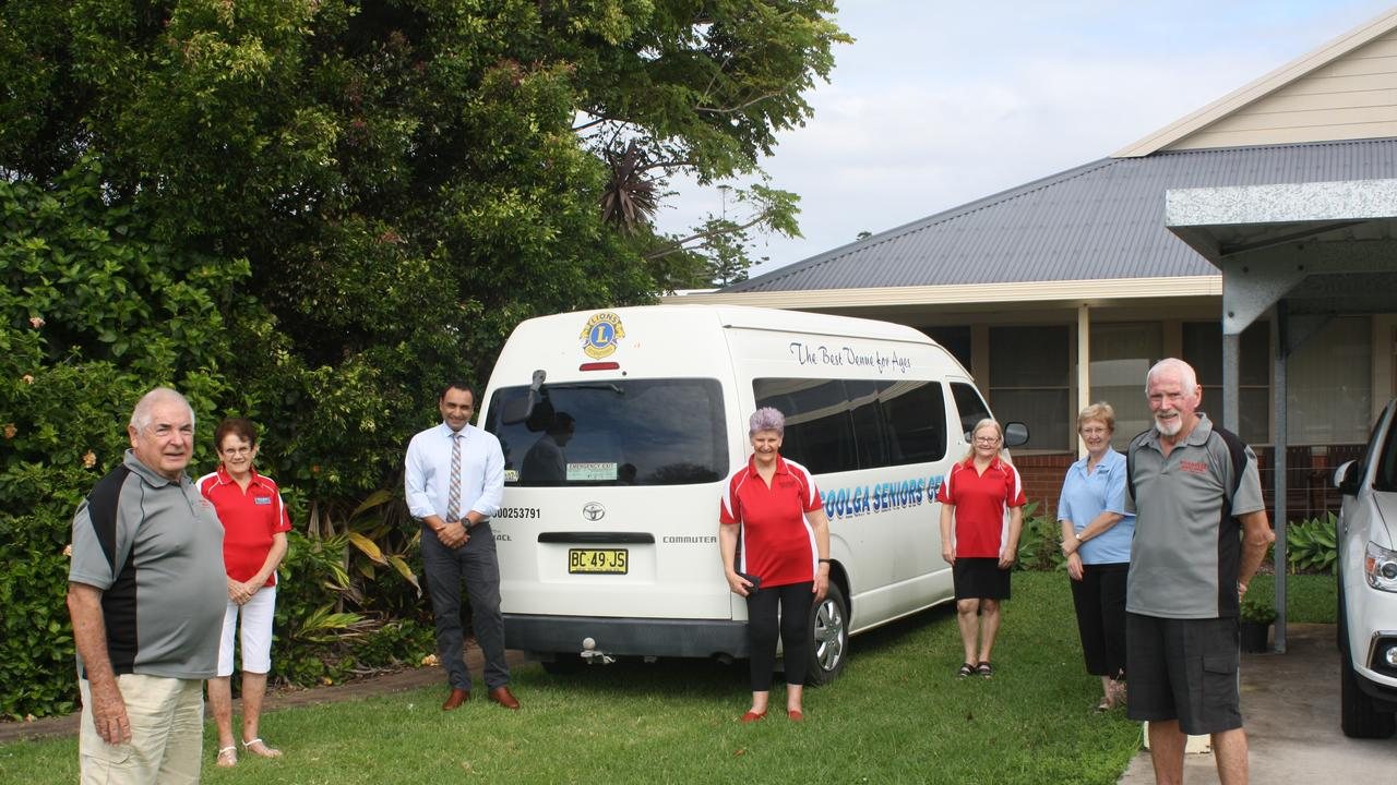 Woolgoolga Seniors Centre committee and support members and State Member for Coffs Harbour Gurmesh Singh celebrate the grant for their new bus: (from left) Roger Freestone, Colleen Williams, Mr Singh, Sue Whelan, Irene Noy, Sharon Wooley and Ron Whelan.