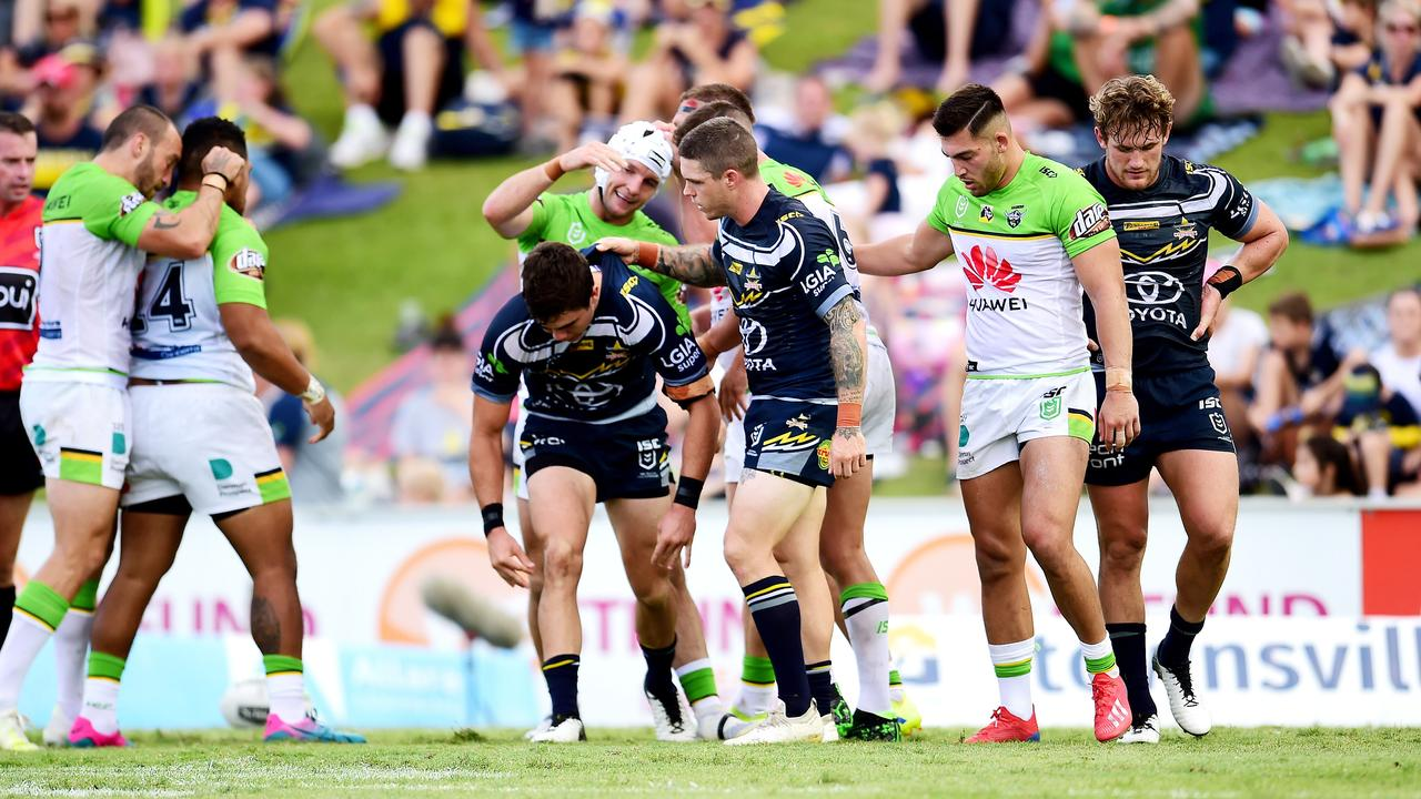 Ben Hampton helps Jake Clifford up. North Queensland Cowboys Vs Canberra Raiders at 1300 Smiles Stadium. Picture: Alix Sweeney