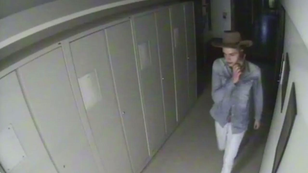 The man was seen wandering darkened corridors in Sydney's Australian Museum. Pictures: NSW Police/Facebook.
