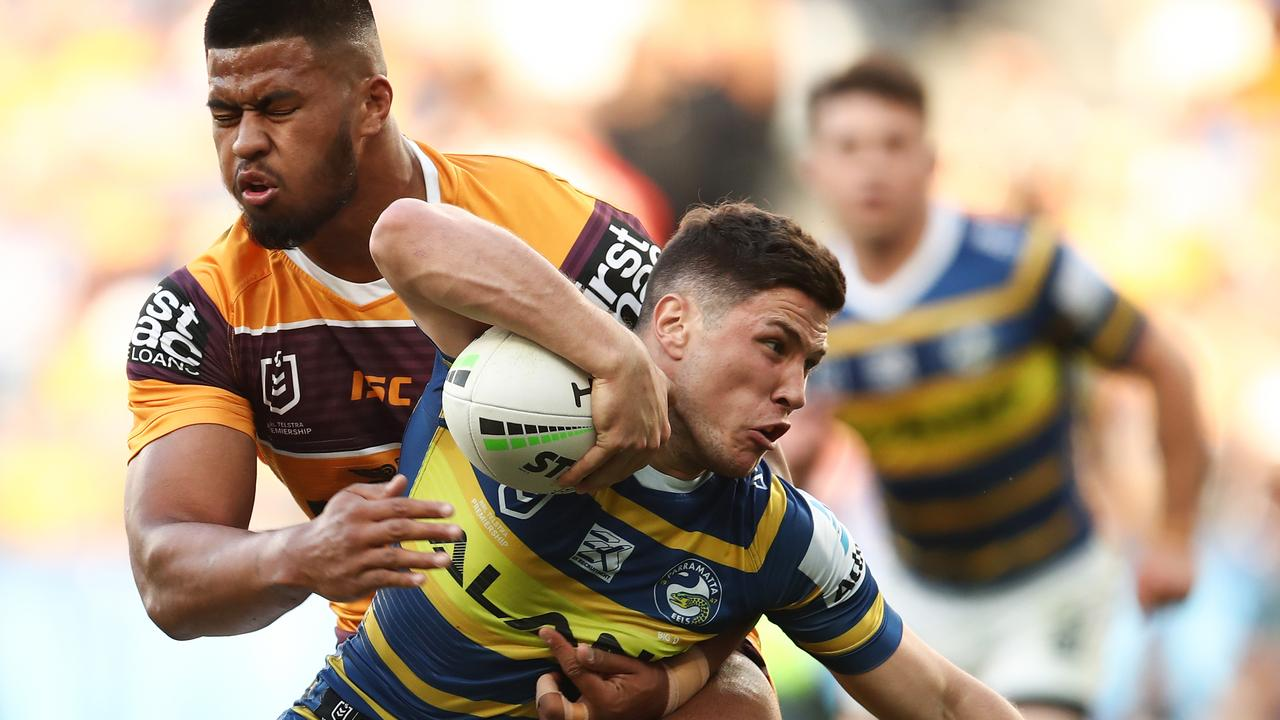Mitchell Moses of the Eels is tackled by Payne Haas of the Broncos during the Second NRL Elimination Final between the Parramatta Eels and the Brisbane Broncos at Bankwest Stadium in Sydney, Sunday, September 15, 2019. (AAP Image/Brendon Thorne) NO ARCHIVING, EDITORIAL USE ONLY