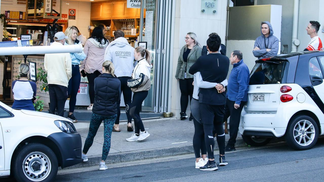 People crowd outside a Bondi cafe.
