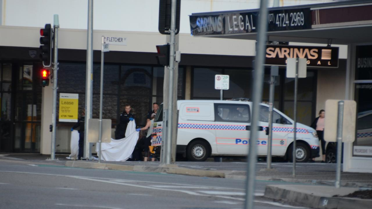 The police at the scene of the deceased body on the corner of Flinders St and Fletcher St.