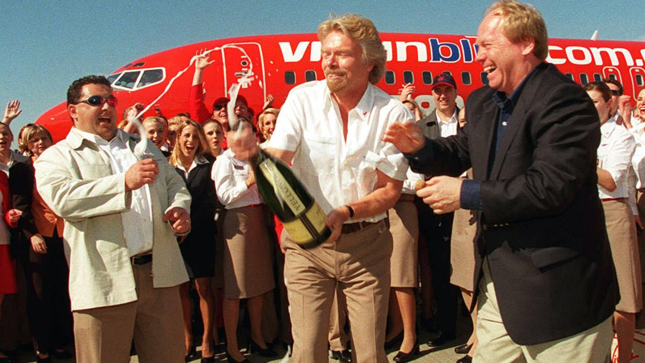 Jul 09 2000 - Virgin blue launch at Brisbane airport  - Richard Branson  and Peter Beattie with champagne surrounded by staff - aviation airlines aircraft personnel