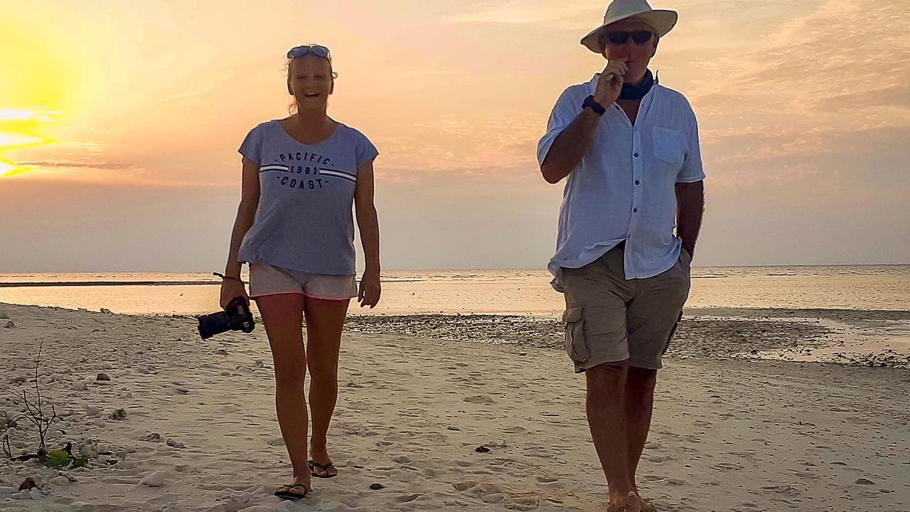Boyd and Andi enjoying a relaxing sunset walk along a secluded beach at Lady Musgrave Island, Great Barrier Reef.