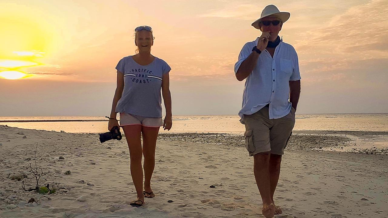 Boyd Jackson and Andi Fabian enjoying a relaxing sunset walk along a secluded beach at Lady Musgrave Island, Great Barrier Reef.