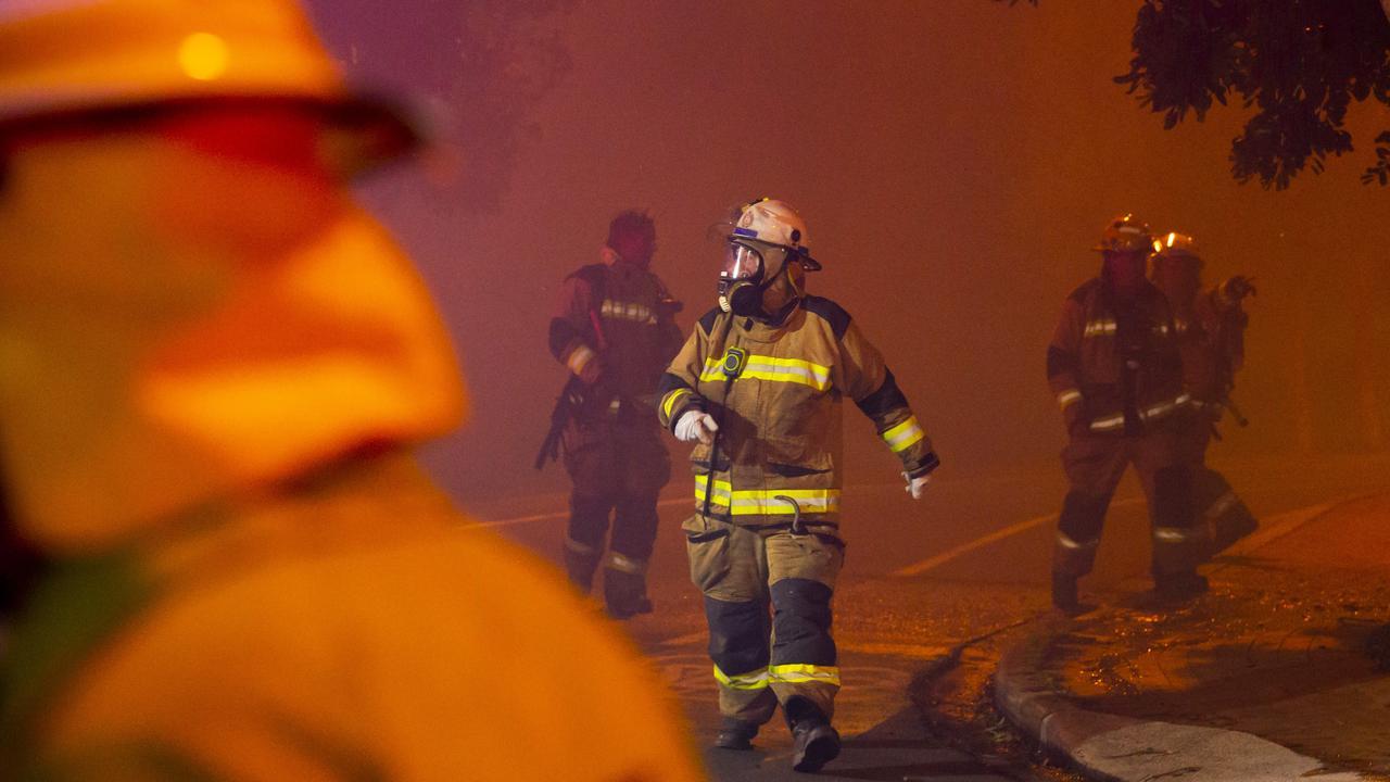 Firefighters battling the wild bushfires that broke out in Peregian Beach last year. Photo: Lachie Millard