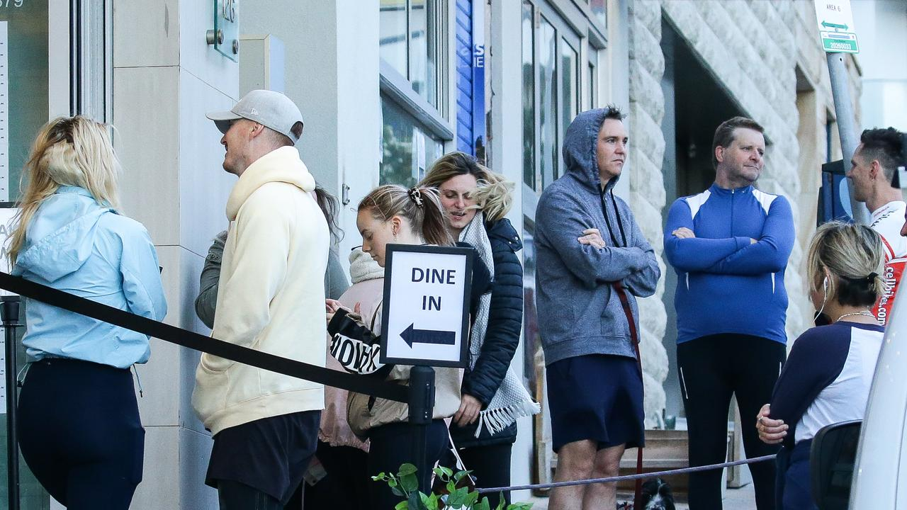 People line up to dine-in cafes in Bondi.