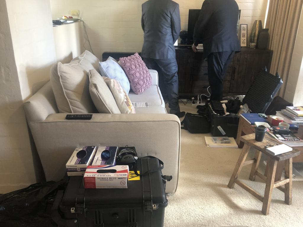 Federal police going through Annika Smethurst's home in Canberra. Picture: Supplied