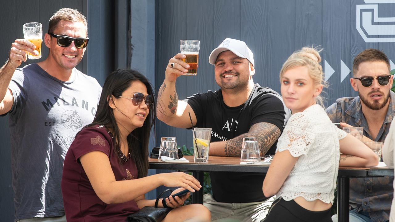 ON TAP: The Northern Territory is officially one of the safest places from coronavirus in the world and patrons at the Darwin Hotel in Darwin celebrated on Friday, May 15, 2020 when the Northern Territory lifted a range of restrictions. (AAP Image/Helen Orr)