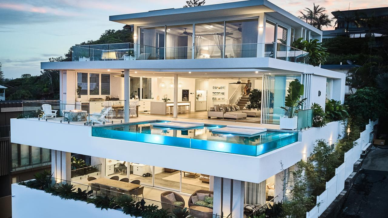 This glamorous mansion is in the running to be named Australia's best house but the glass edge pool is already a star attraction.