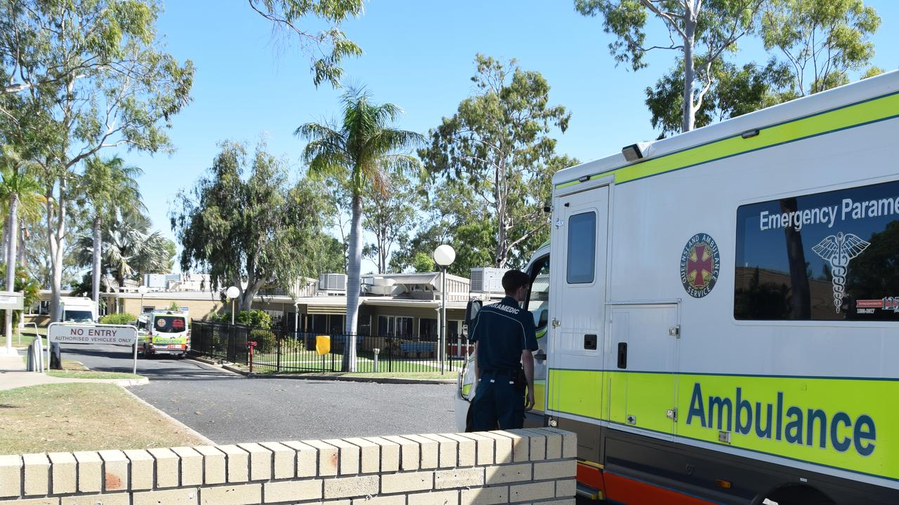 Ambulances queue outside of North Rockhampton Nursing Centre as the transfer of some patients commence.