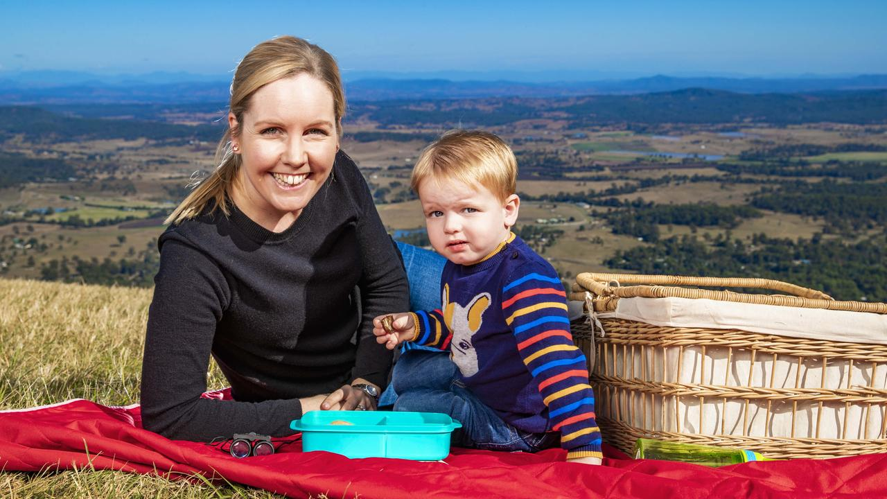 Lara Suddards and son Alex, 2, enjoy a picnic at Mt Tamborine to celebrate eased restrictions. Picture: NIGEL HALLETT