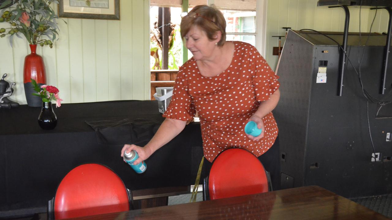 COME ON IN: Mungungo pub owner Dani Meers disinfecting tables during the first stage of the state government's coronavirus road map. Picture: Sam Turner