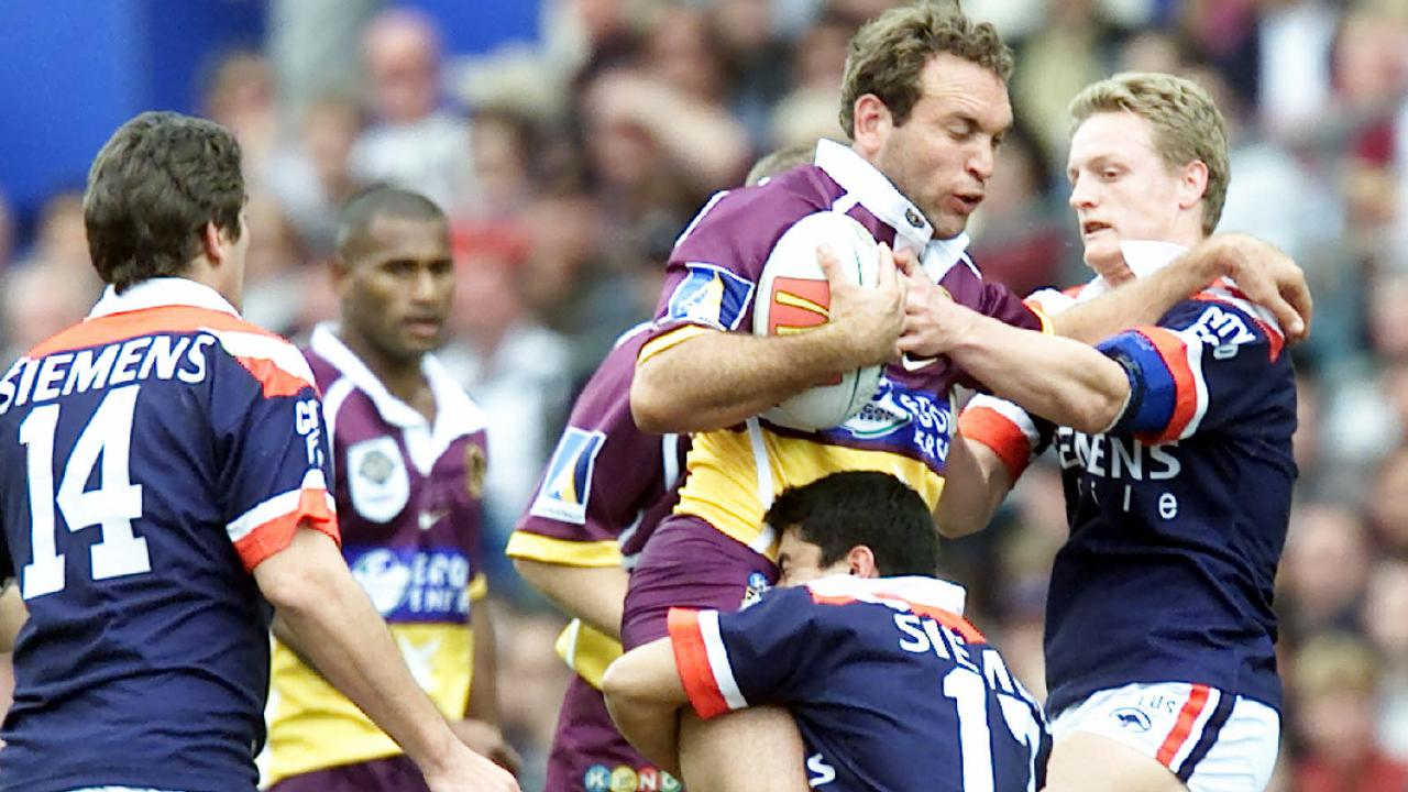 27 Aug 2000 D/I NRL grand final Broncos vs Sydney Roosters at Stadium Australia. picDavid/Kapernick sport rugby league action. Gorden Tallis tackled by Craig Wing and Ryan Cross.