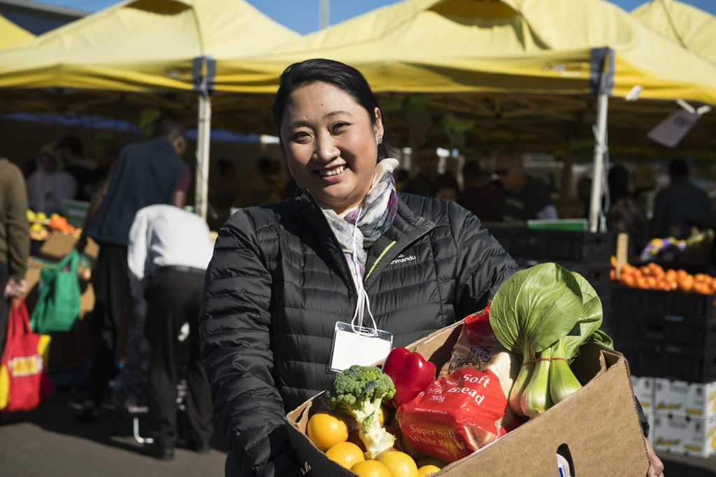Image for sale: Cathy Pham was overwhelmed by demand for her donated fresh fruit and vegetables for international students in isolation at PCYC markets, Sunday, May 17, 2020. Picture: Kevin Farmer