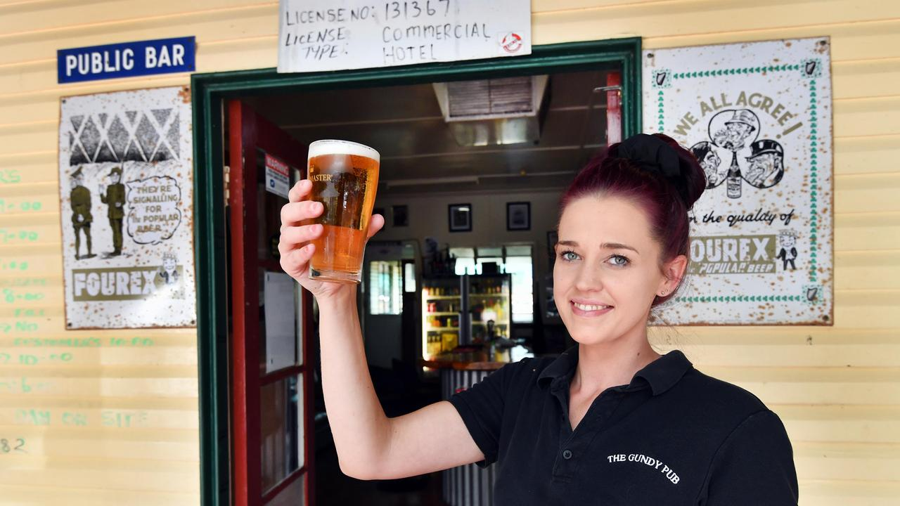 Gundy Pub bar manager Katy Rivette was all smiles as she welcomed patrons back to the hotel in Gundiah. Photo: Alistair Brightman.