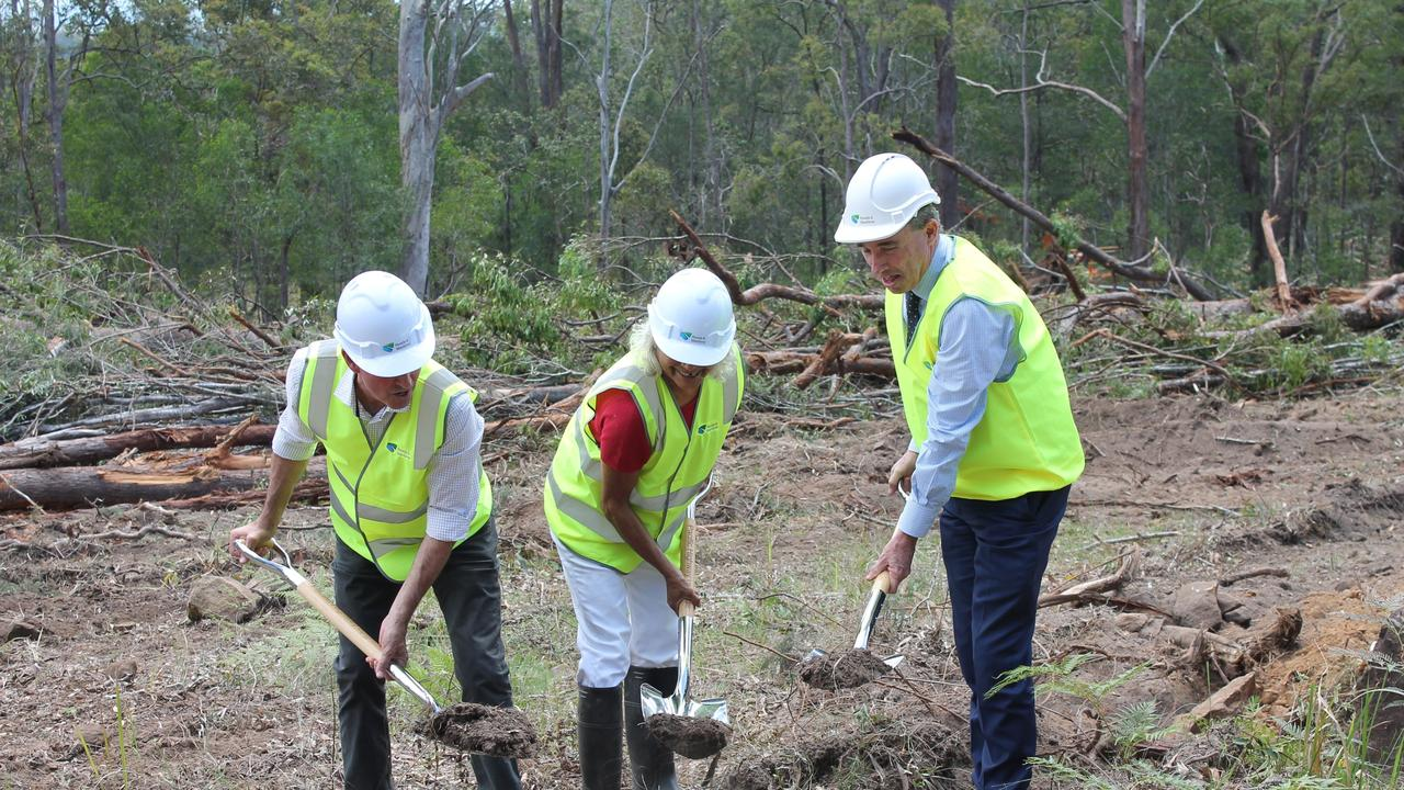 EARLY DAYS: Clarence MP Chris Gulaptis, Deidre Randell from RMS and Page MP Kevin Hogan dig the first soil on for the Glenugie to Tyndale Pacific Highway build in October 2016.