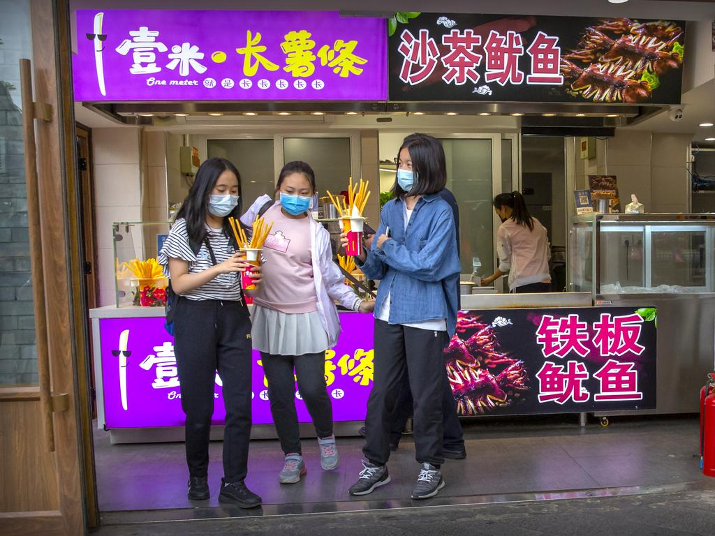 People wearing face masks to protect against the spread of the new coronavirus. Picture: AFP