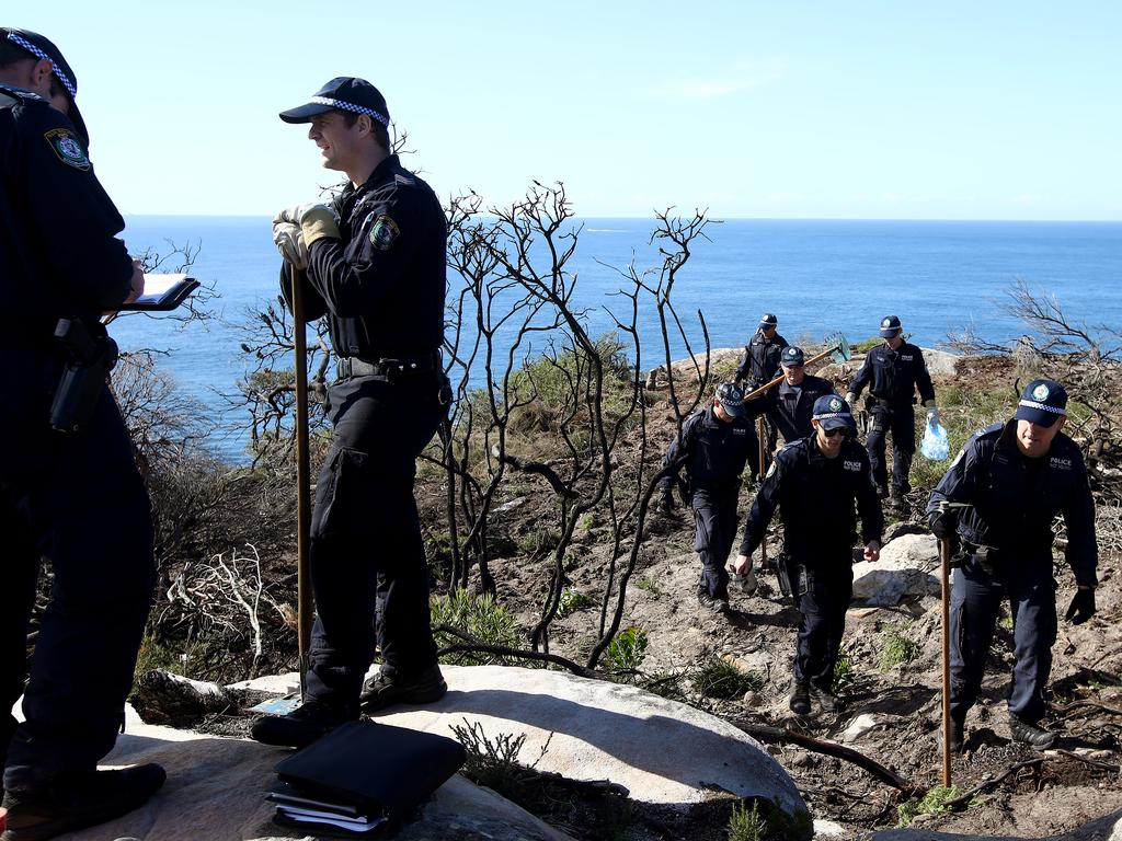 NSW Police search an area on North Head near Manly looking for evidence after a man was arrested earlier today over the 1988 murder of Scott Johnson. Pic: Toby Zerna