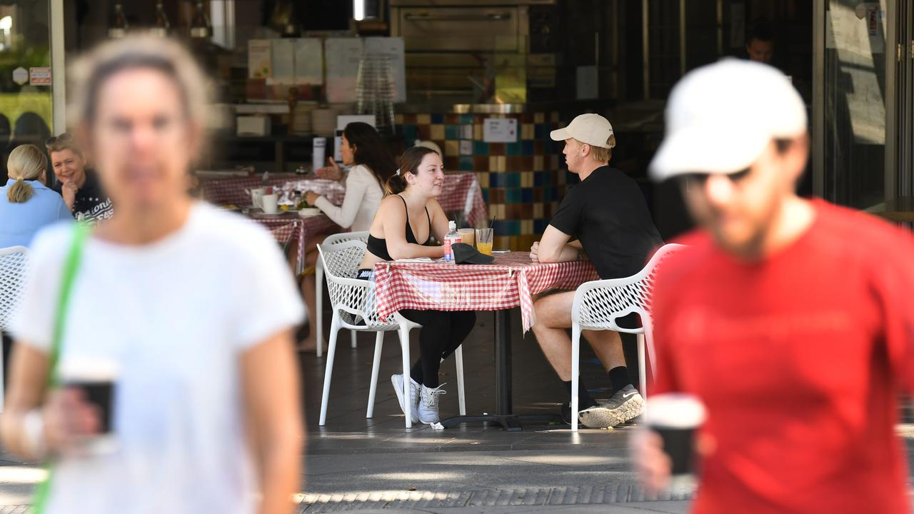 Cafe customers sit at tables distanced from each other in South Bank. (AAP Image/Dan Peled)