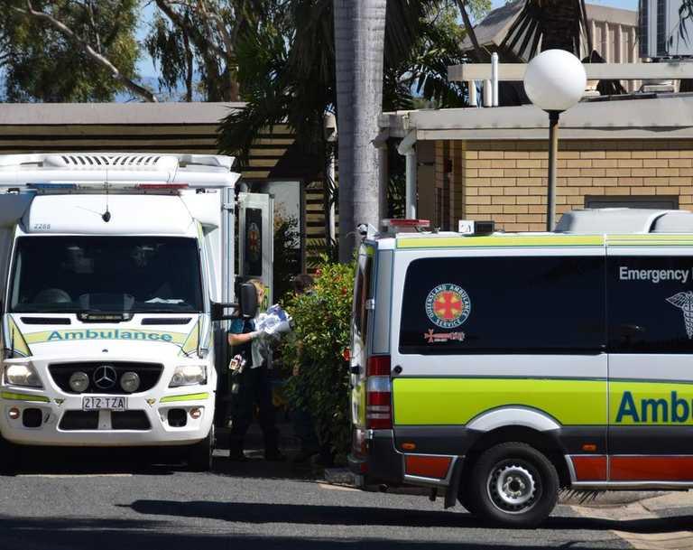 Ambulances queue outside of North Rockhampton Nursing Centre as the transfer of some patients commence.