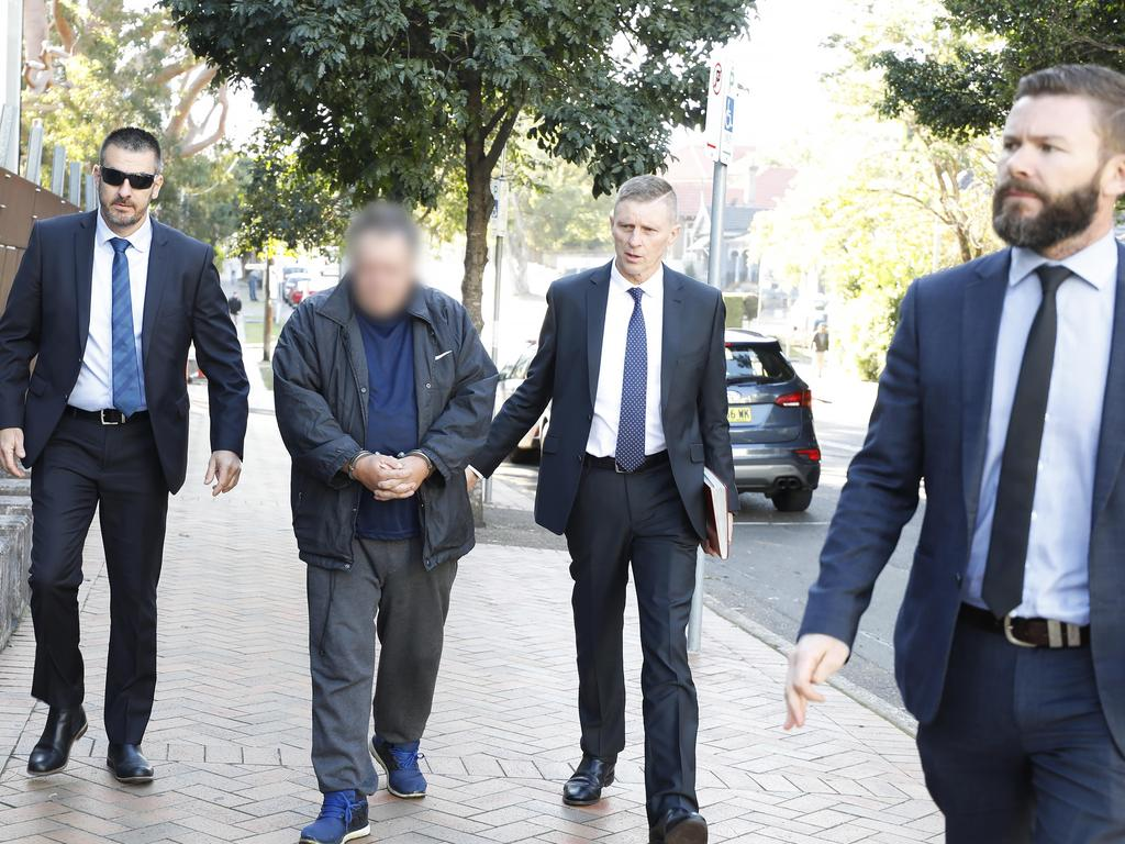 Strike Force Welsford: Detective Sergeant John Breda, Detective Chief Inspector Peter Yeomans and Detective Senior Constable Tim Carey arrest Scott Phillip White (blurred) over the alleged murder of Scott Johnson. Pic: NSW Police