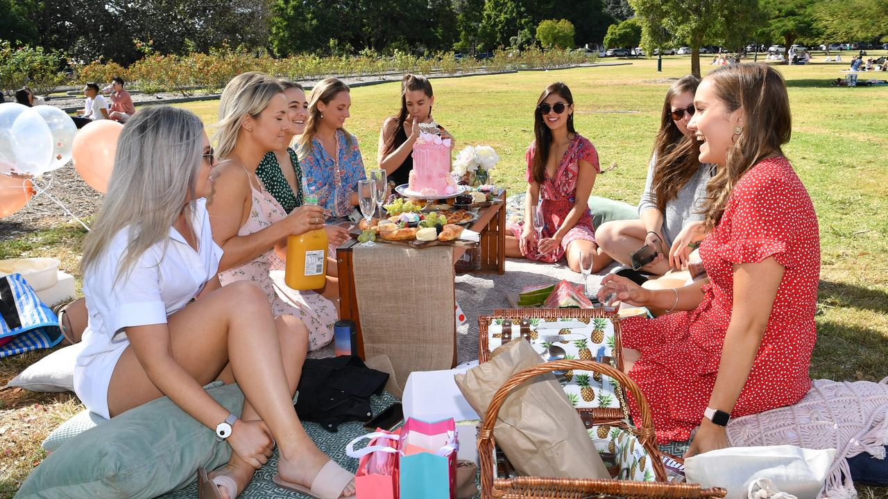 A group of women are seen celebrating a birthday in New Farm Park. Picture: AAP Image/Darren England