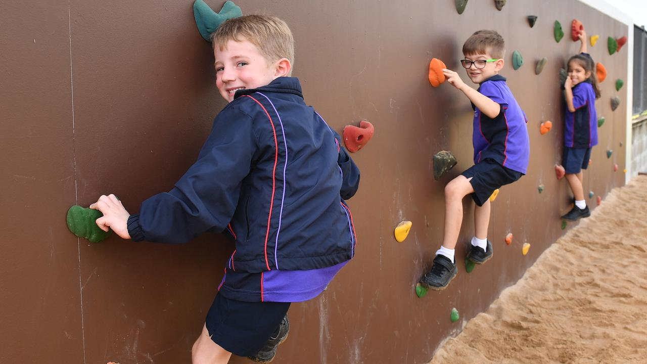 St Brendan's Catholic School prep students Buster Carrington, Bailey Martin and Elise Guglielmino play on the new playground at the school. Picture: Tony Martin