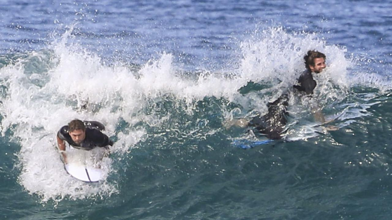 Chris and Liam Hemsworth surfing in Byron Bay. Picture: Media Mode