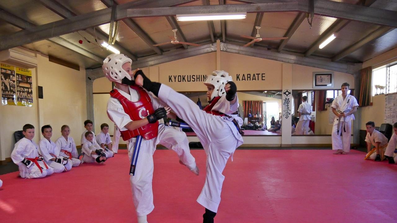Eighth Kyu karate students Kade Harrison, 9, from Cannonvale Dojo and Jake Johns, 8, from Proserpine Dojo sparring in preparation for the weekend's tournament.