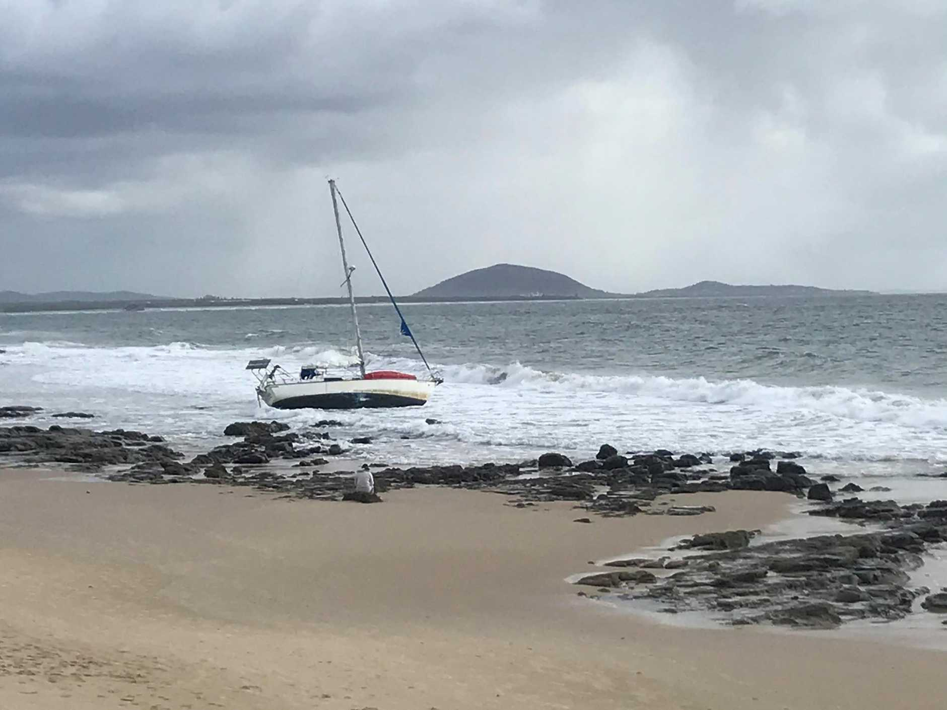 Authorities have commenced a search after a yacht washed up on Mooloolaba Beach this morning.
