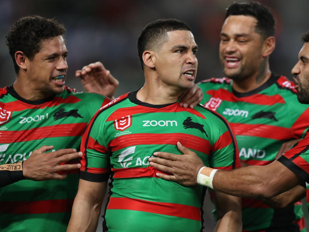 Souths players gather around Cody Walker.