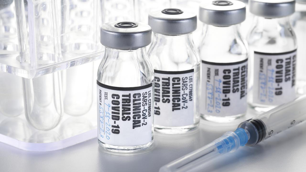 Clinical Trial – Vaccine: COVID-19, coronavirus in vial with syringe on white background. Fake label.